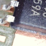 microscope view of SOIC-8 chip on pad